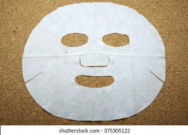Facial mask on cork message/bulletin board.