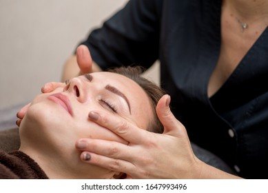 facial massage in the spa. Beautician does facial massage.