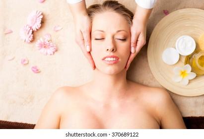 Facial massage at spa studio
