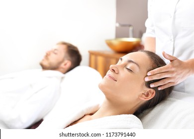 Facial massage for two.  A woman and a man together on a care treatment in a spa salon.
