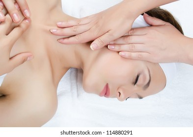 Facial massage to the woman close up