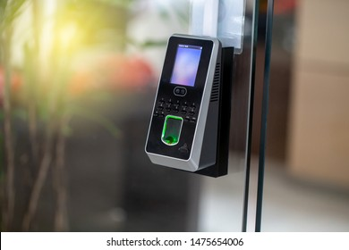 Facial recognition and fingerprints scanner machine for access door security and for records time attendance. Close up and selective Focus.