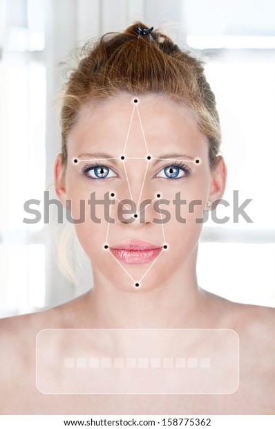 FAcial recognition software recognizing a face of beautiful young woman