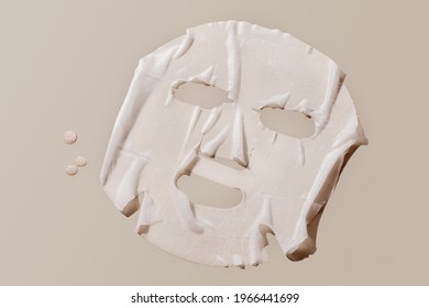 facial sheet mask on brown background.