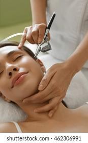 Facial Skin Care. Closeup Of Beautiful Woman Receiving Face Oxygen Peeling At Cosmetology Center. Girl Enjoying Skin Rejuvenation Procedure. Beauty Treatment Concept. High Resolution Image