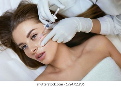 Facial Skincare Injection In Cosmetic Clinic. Face Lifting And Biorevitalization For Healthy Female Model In Beauty Salon.