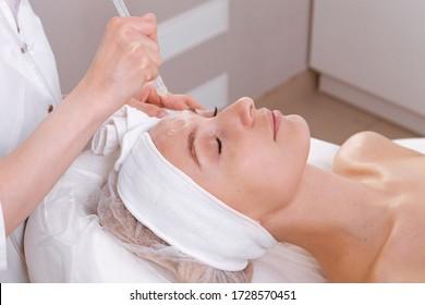Facial treatment. Beauty face care, gas-liquid procedure for woman over 30. Skin care concept.