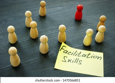 Facilitation skills concept. Wooden figurines as symbol of teamwork.