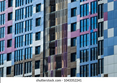 Facing the building with a ventilated facade. Aluminum colored facades. Modern facades of high-rise buildings. Construction of a large residential complex.