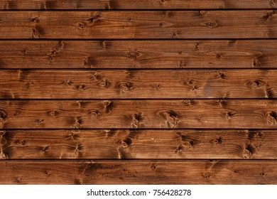 Facing a wooden house as a beautiful texture