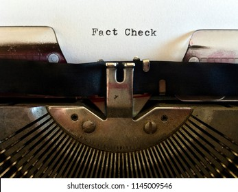 Fact Check, heading title typewritten in black ink on white paper on vintage retro old fashioned obsolete typewriter machine