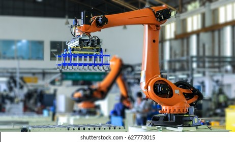 Factory 4.0 concept. Industrial robot in smart warehouse system for manufacture factory
