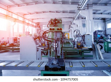 Factory for aluminum and PVC windows and doors production. Details industrial equipment. Background