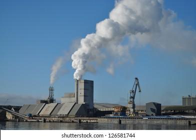 Factory at Amsterdam harbor venting smoke
