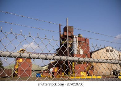 Factory behind barbed wire fence