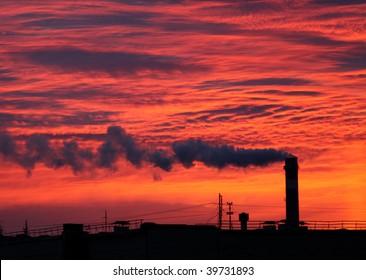 Factory chimney at sunrise