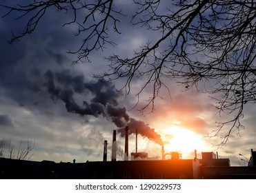 Factory chimneys with black smoke. Factory smokestacks. Air pollution. Environment pollution concept. Ecological disaster concept.