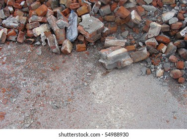 factory demolition stone stack of rubble on concrete floor