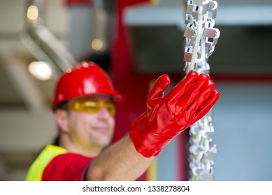 Factory engineer checking production line with red protective gloves