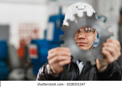 factory engineer checks the quality of the manufactured part