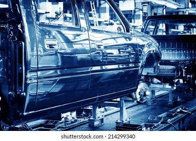 Factory floor, car production lines.