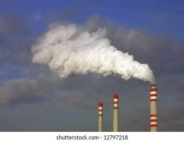 factory fumes from chimney lighting sunlight