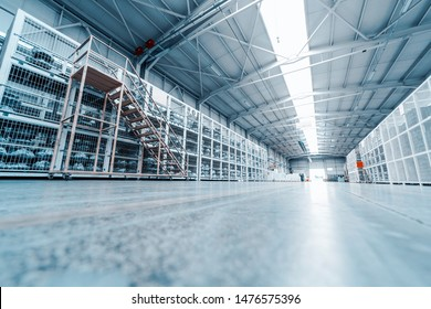 factory indoor. warehouse interior with shelves, pallets and boxes. Large modern empty industrial premises