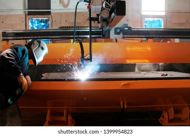factory interior, worker and cnc machine