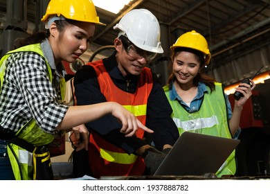 Factory job workers working and discussing manufacturing plan in the factory . Industry and engineering concept .