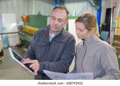 factory looking at the design on the tablet