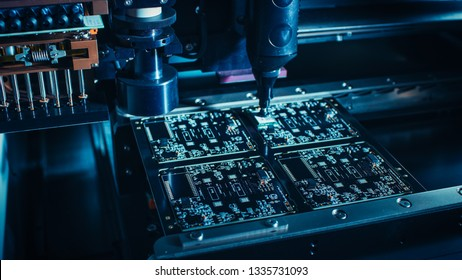 Factory Machinery at Work: Printed Circuit Board Being Assembled with Automated Robotic Arm, Surface Mounted Technology Connecting Microchips to the Motherboard. Macro Close-up.
