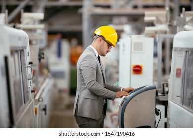Factory manager in inspection of manufacturing. Man in Industrial Environment.