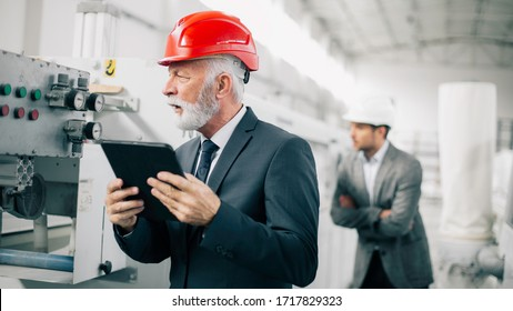 Factory manager in inspection of manufacturing. Man in Industrial Environment