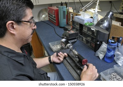 Factory manufacturing worker checking quality of parts