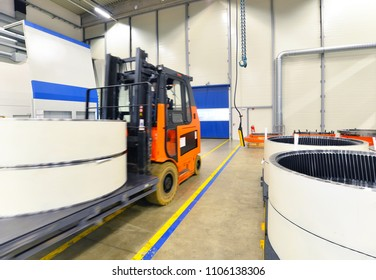 Factory of modern mechanical engineering - production of gearboxes for wind turbines - forklift truck transportation