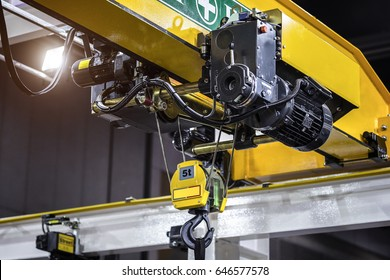 Factory need to use crane lifting work overhead a yellow beam.