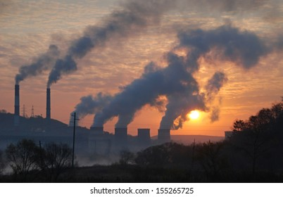 Factory pipe polluting air, environmental problems, ecology theme, the smoke from the chimneys