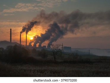 Factory pipe polluting air, smoke from chimneys against sunset, environmental problems, ecology theme