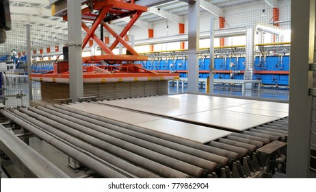 Factory for Production of Ceramic Tiles. Blanking and Piercing of Ceramic Tiles. Conveyer Line For Ceramic Tile At Heavy Plant. The Process of Making Ceramic Tiles