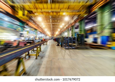 Factory shop, view from floor point. Abstract industrial background, motion blur effect.