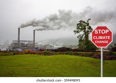 factory with smog and stop sign