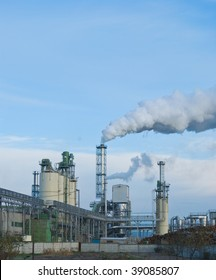 factory smoke, contaminating air with overcast sky