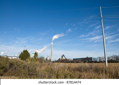 Factory and Smoke Stack Releasing Pollution into the Sky