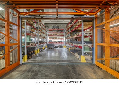 Factory warehouse steel reinforcement. High stacked shelving. Industrial distribution warehouse.