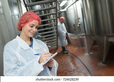 factory worker cleaning floor