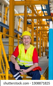 Factory worker laughing in a factory