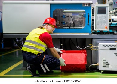 Factory worker maintaining a factory machine