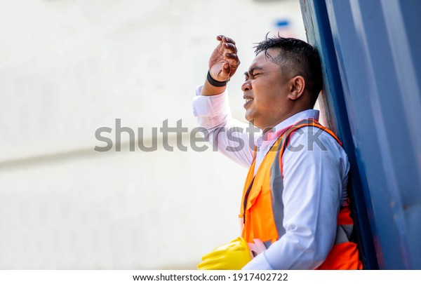 Factory worker man working in hot weather and he look tired from work.