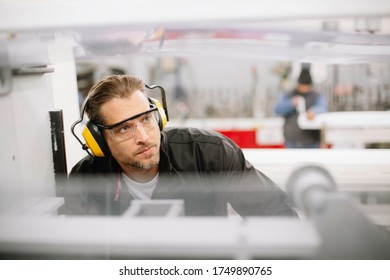Factory worker. Man working  on the production line.