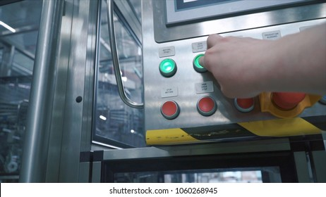 Factory worker presses the button on the control point and starts conveyor of production line, first person view. Clip. Computer controlled production line. Modern food factory. Automated conveyor
